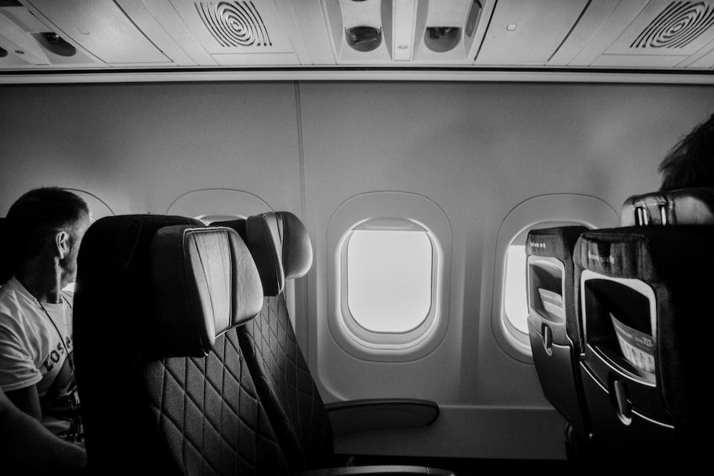 gray scale photo of train seat
