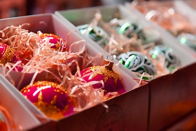 assorted candies on white plastic container ornaments teams background