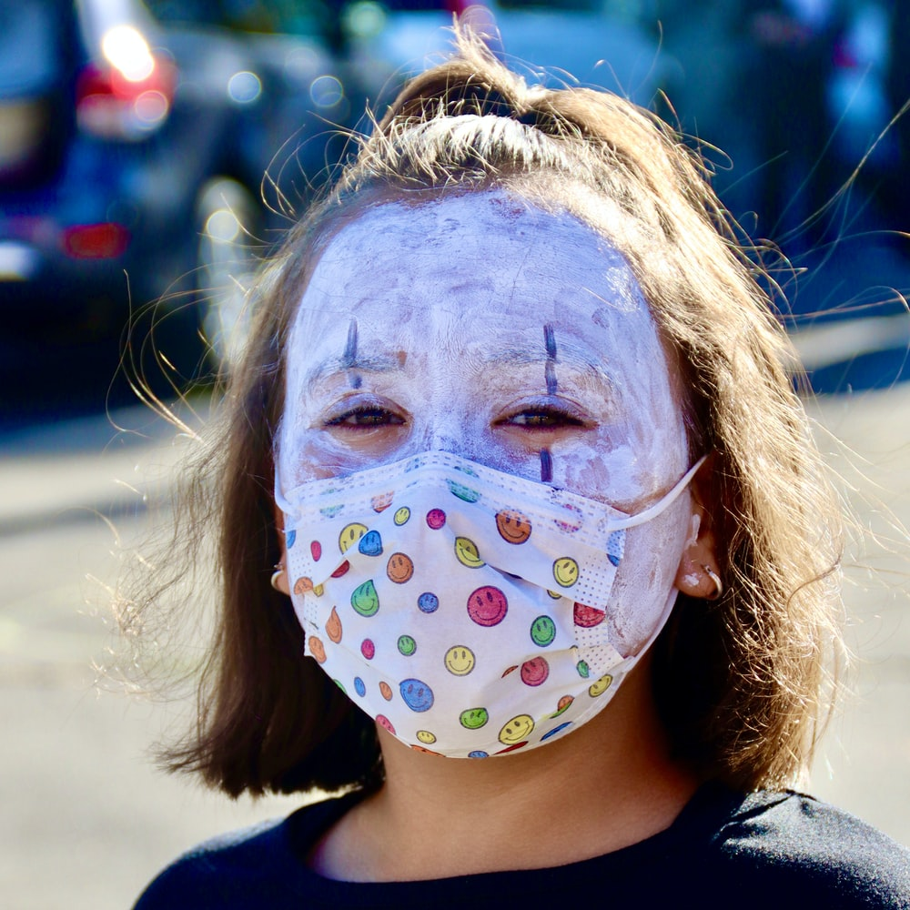 girl with face paint wearing black shirt