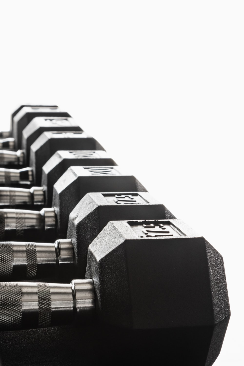 black and silver dumbbells on white background