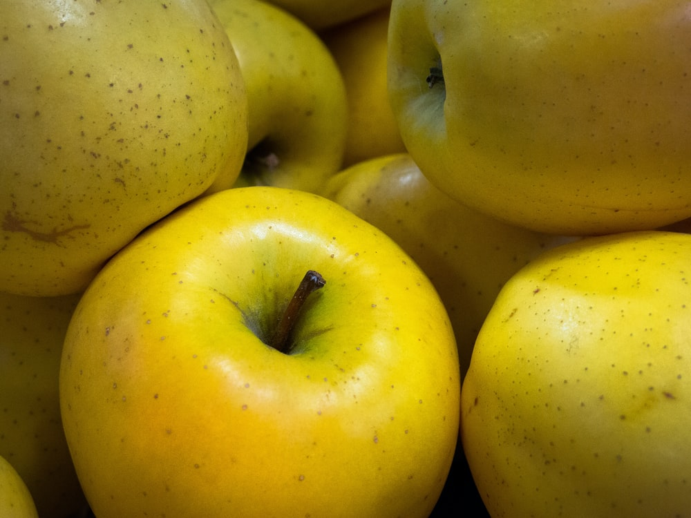 green apple fruit on yellow plastic container