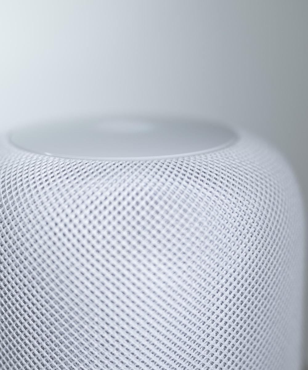 white round speaker on white table