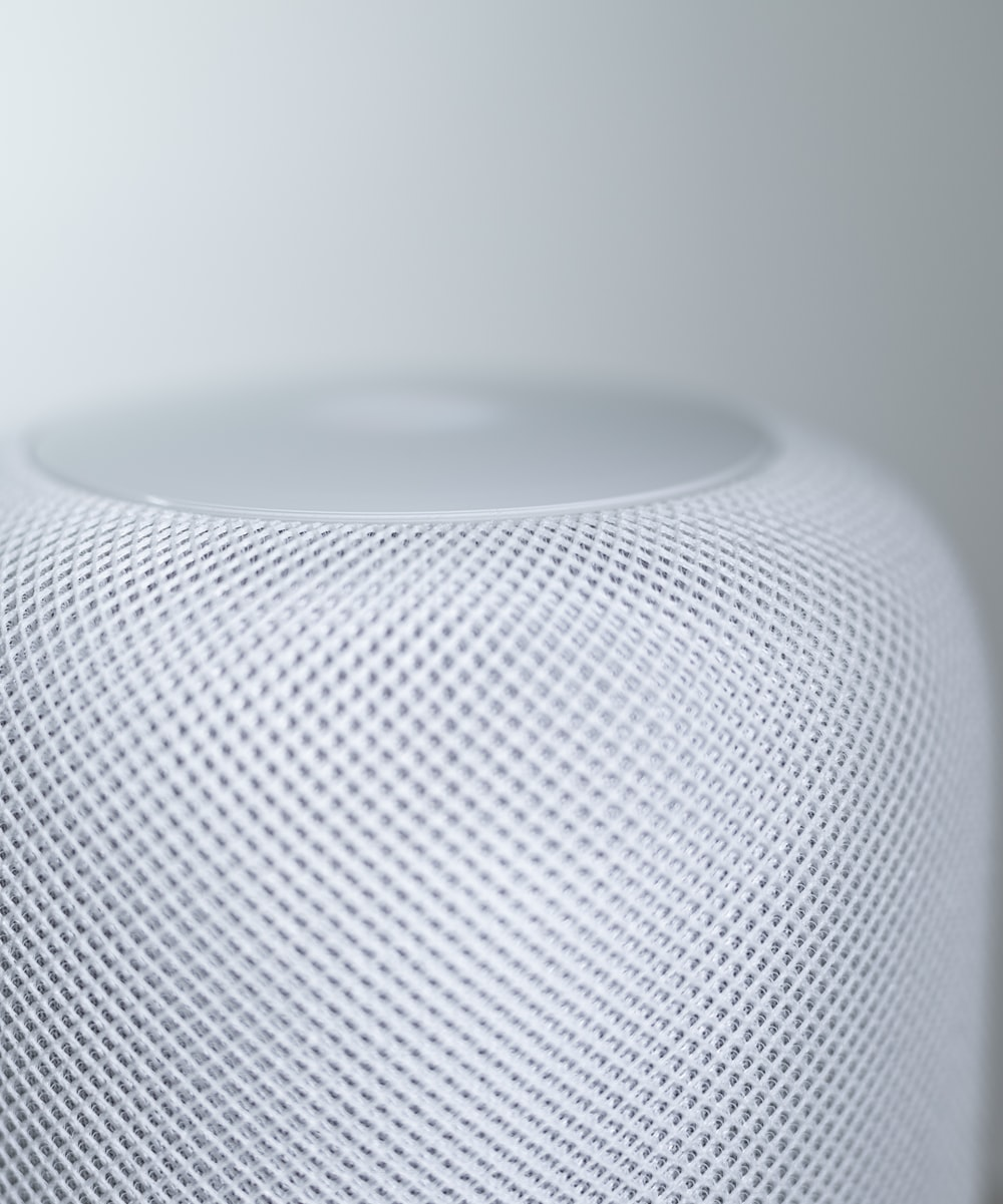 white round speaker on white table