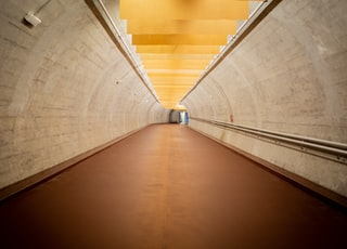 brown wooden hallway with yellow walls