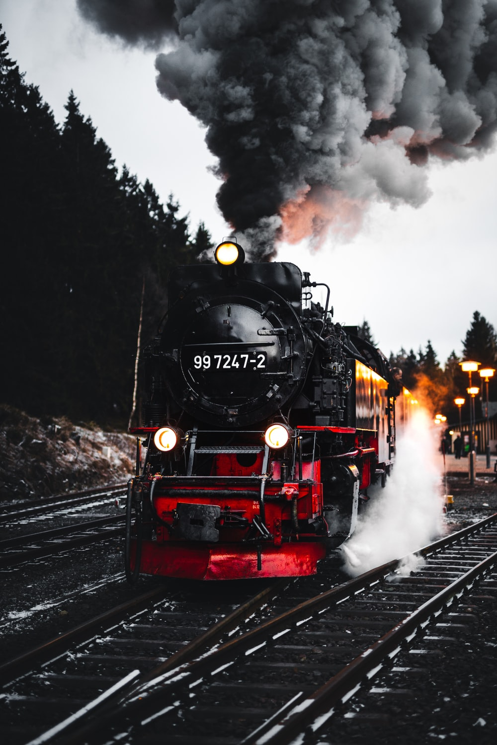 red and black train on rail road during daytime