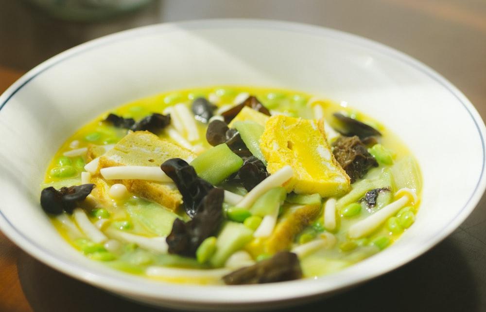green vegetable dish on white ceramic plate