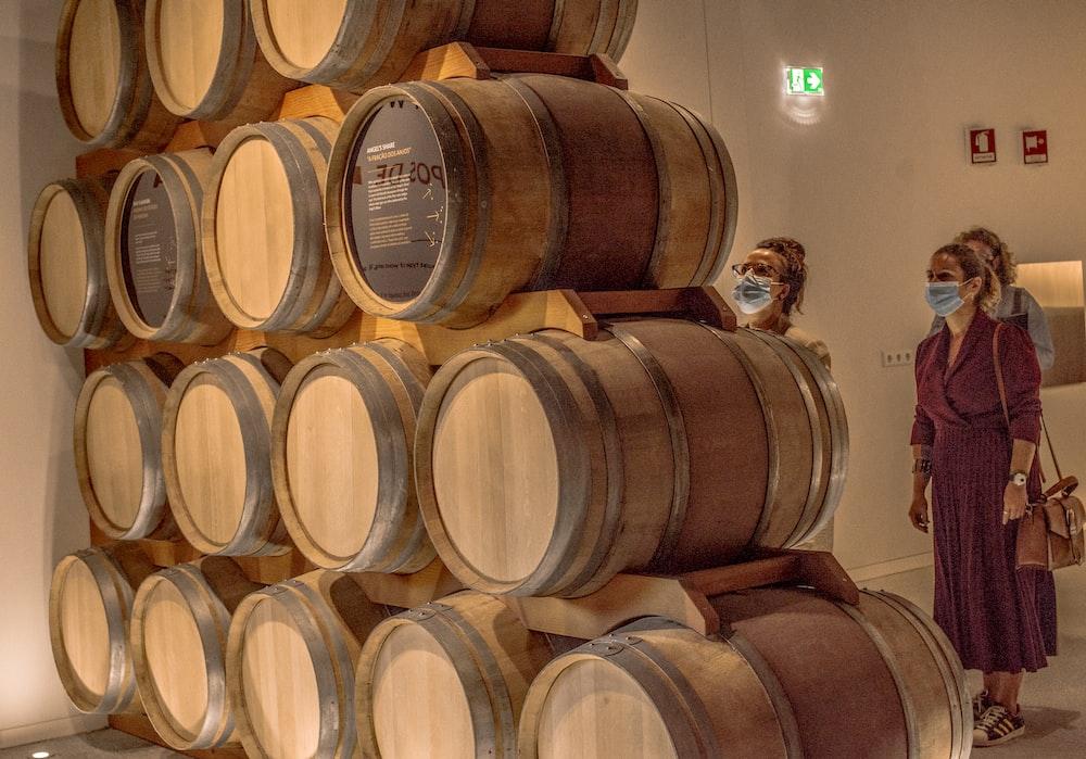 brown wooden barrels on brown wooden barrels