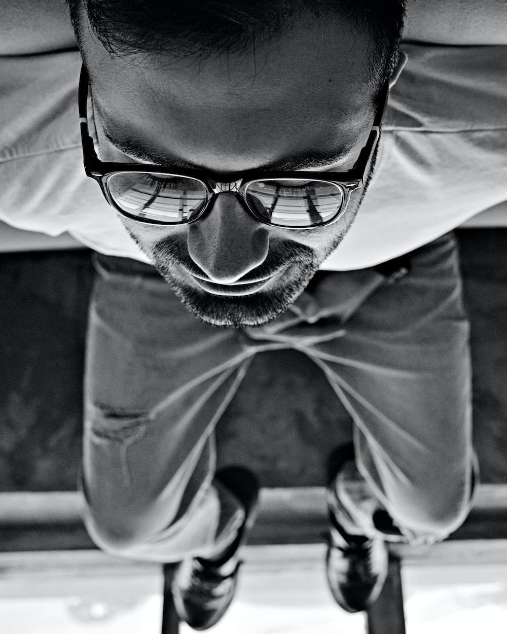 man in white shirt and black framed eyeglasses