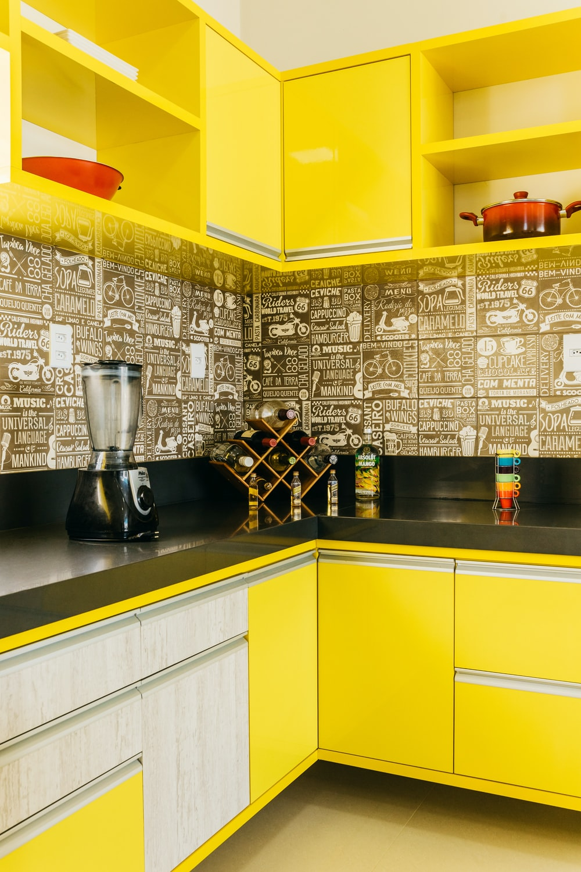 stainless steel coffee maker on black granite counter top