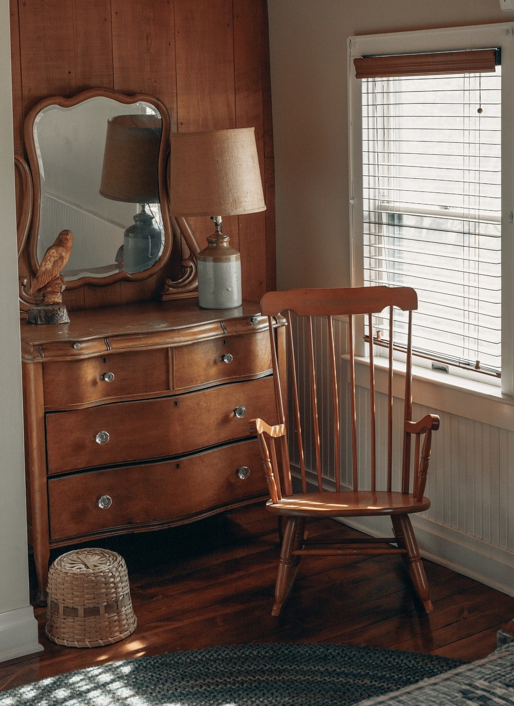 brown wooden chair beside brown wooden drawer