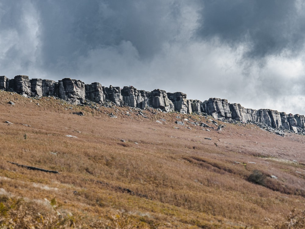gray rock formation under gray clouds
