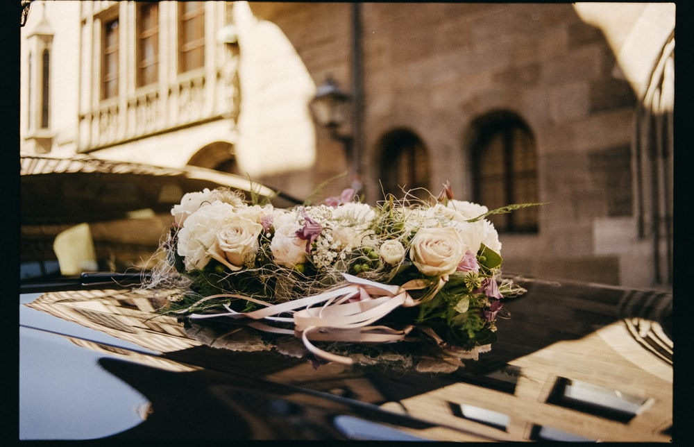 bouquet of white and pink roses on table