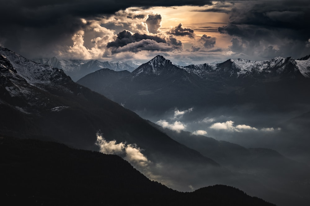 black and white mountains under white clouds during daytime