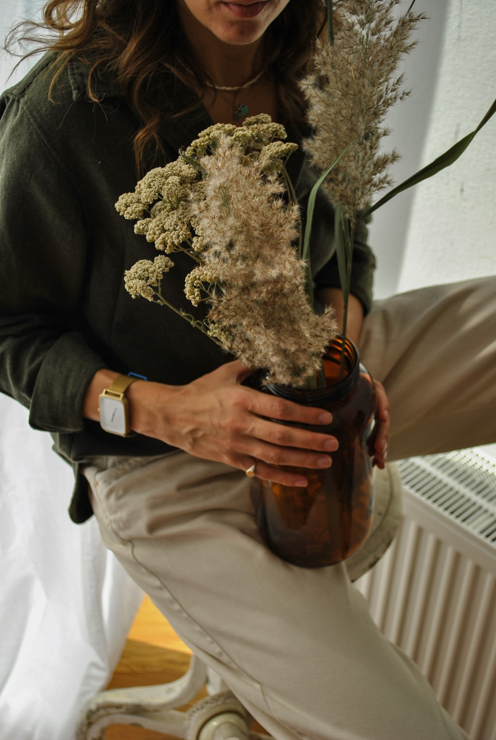 person holding bouquet of white flowers