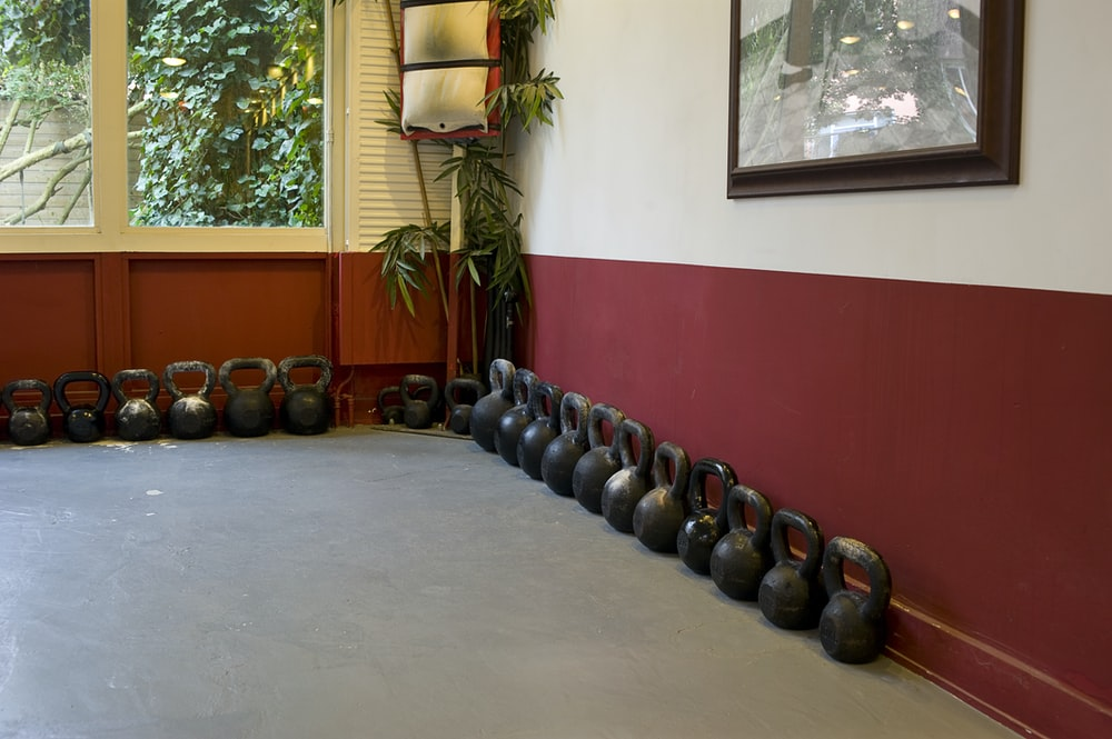 black and blue exercise equipments