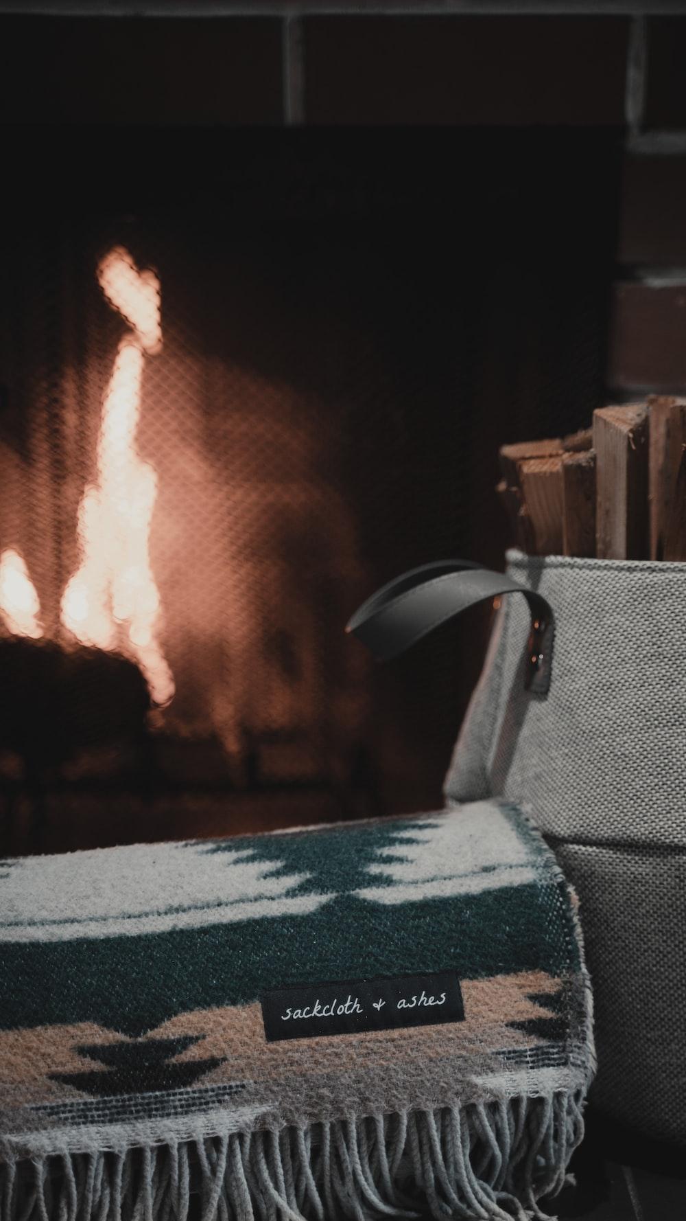 black leather armchair near fire