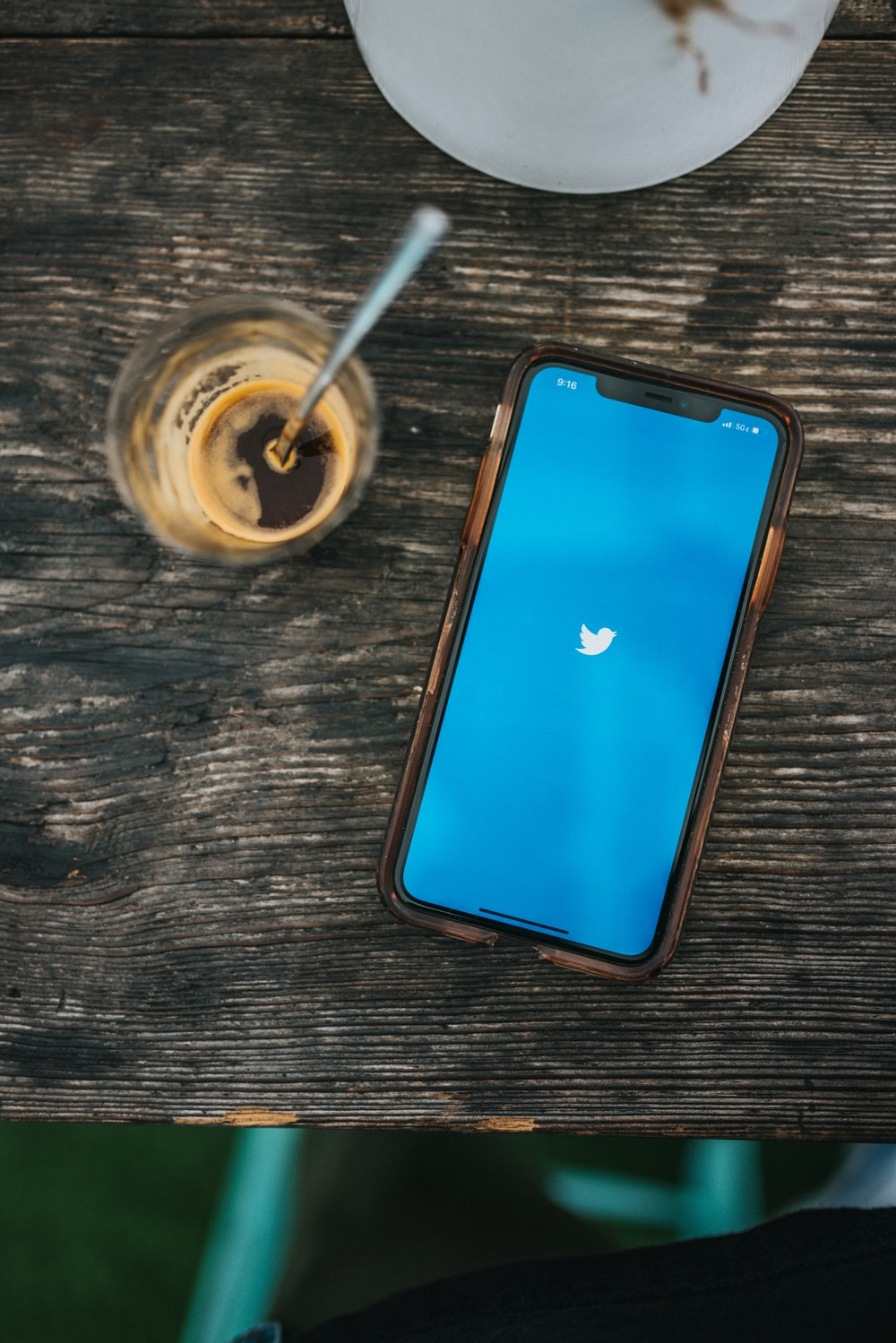 blue ipod touch on brown wooden table