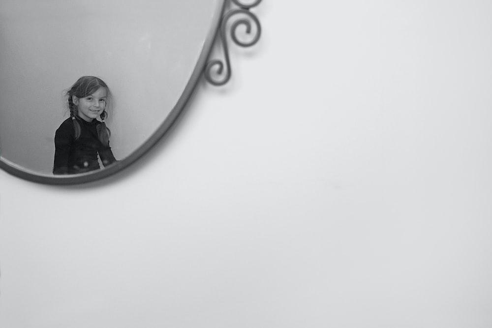 silver round mirror on white wall