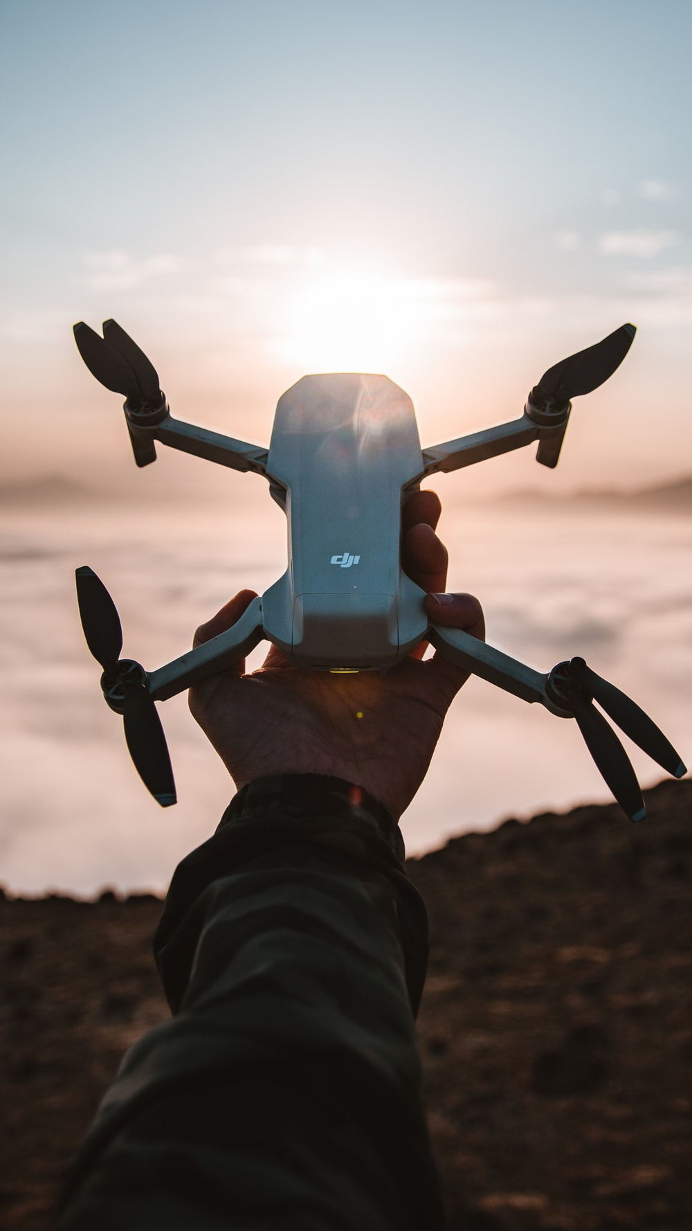 person holding gray and black drone