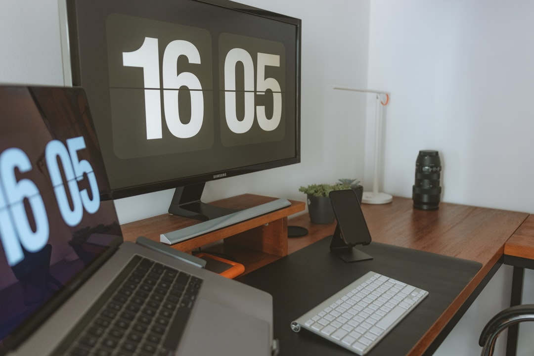 Black Flat Screen Computer Monitor On Brown Wooden Desk - unsplash