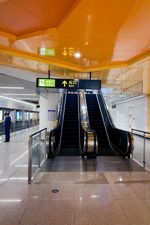 black escalator inside a building