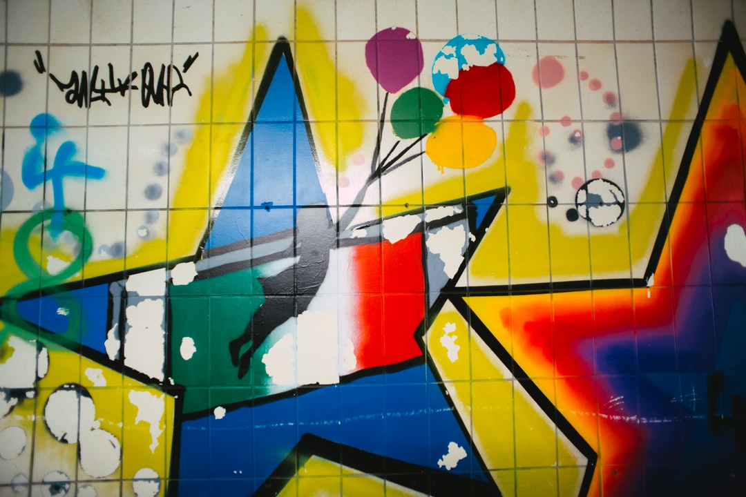 Urban Street Art At Metro Railroad Station – Colorful Graffiti. Made With Analog Vintage Lens, Carl Zeiss Jena Flektogon Red Mc 2.8 20mm (year: 1976) - unsplash