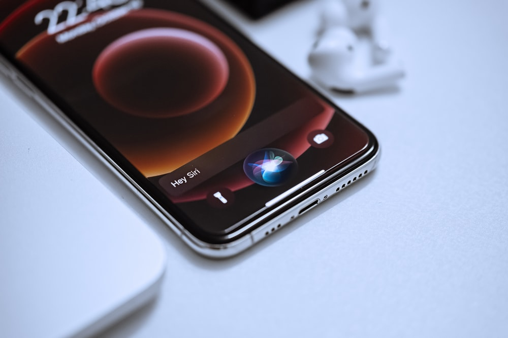 black android smartphone on white table