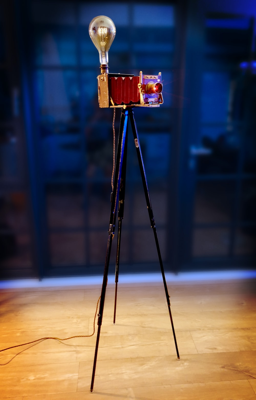 red and black camera on tripod