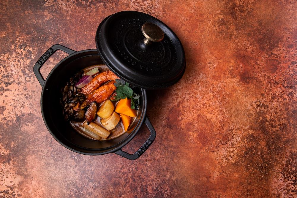 black cooking pan with food