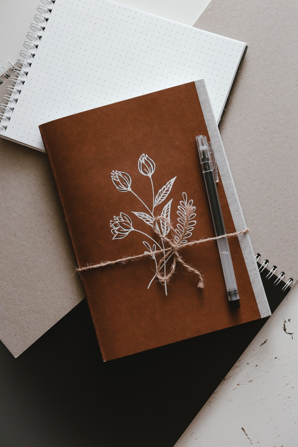brown and white book on white paper