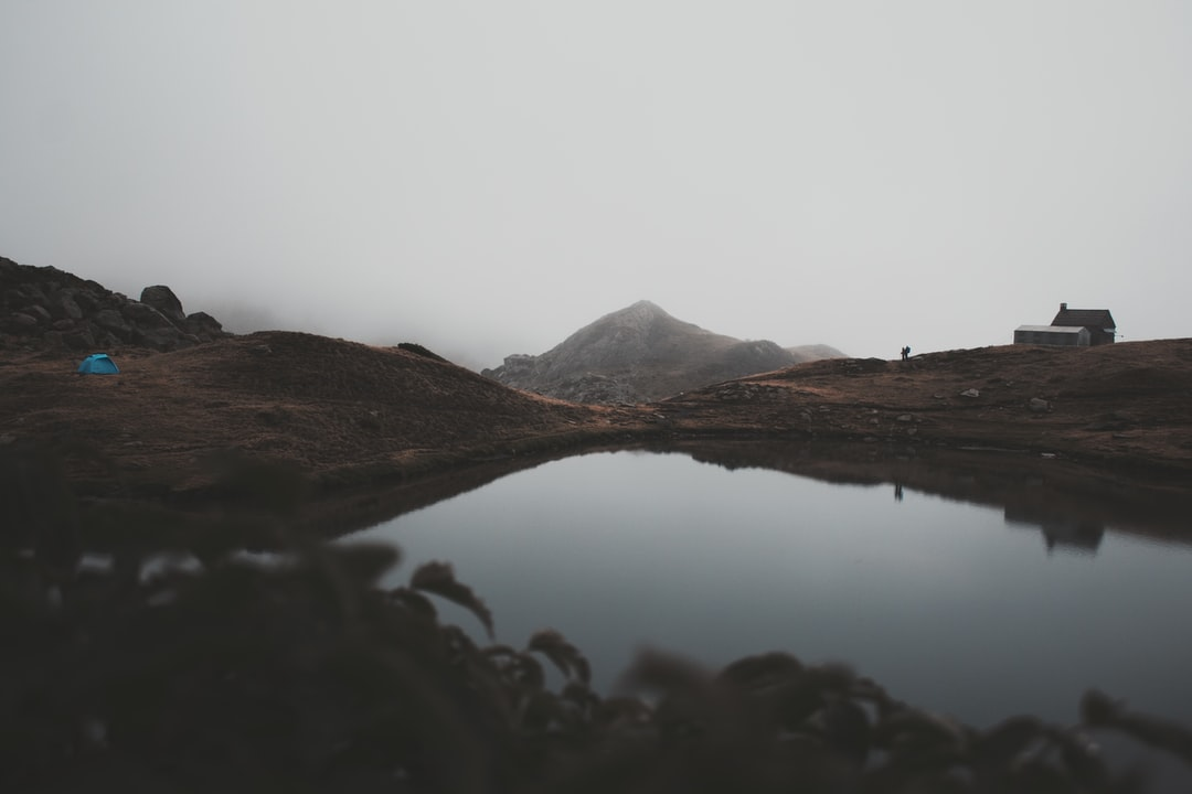 Brown Mountain Near Body of Water - unsplash