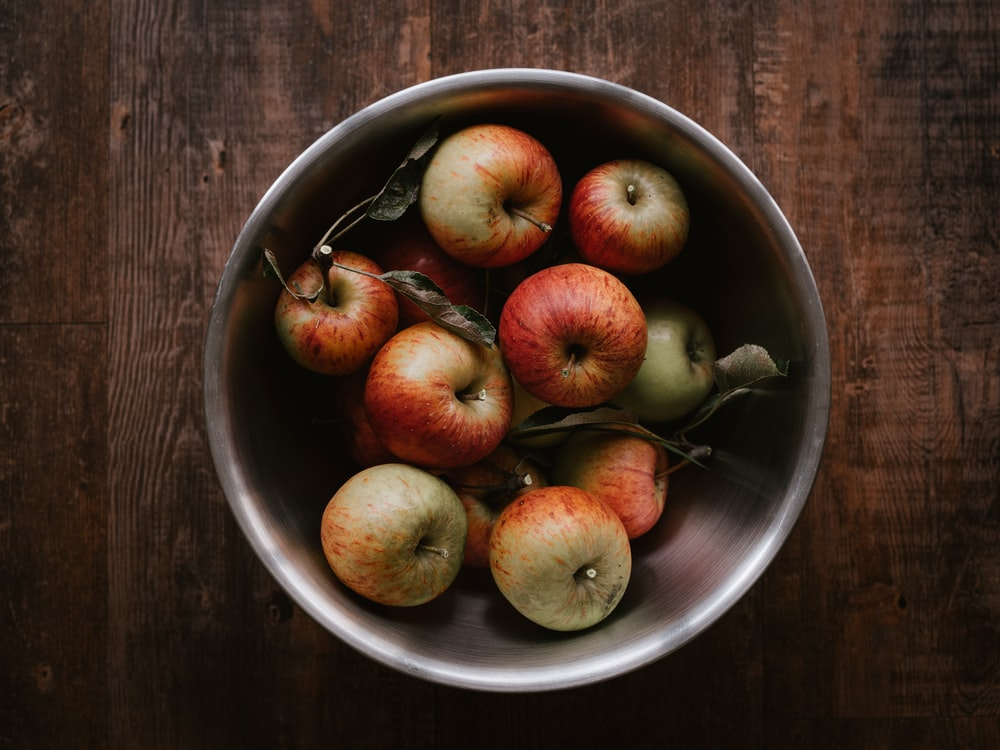 red apples on stainless steel bowl