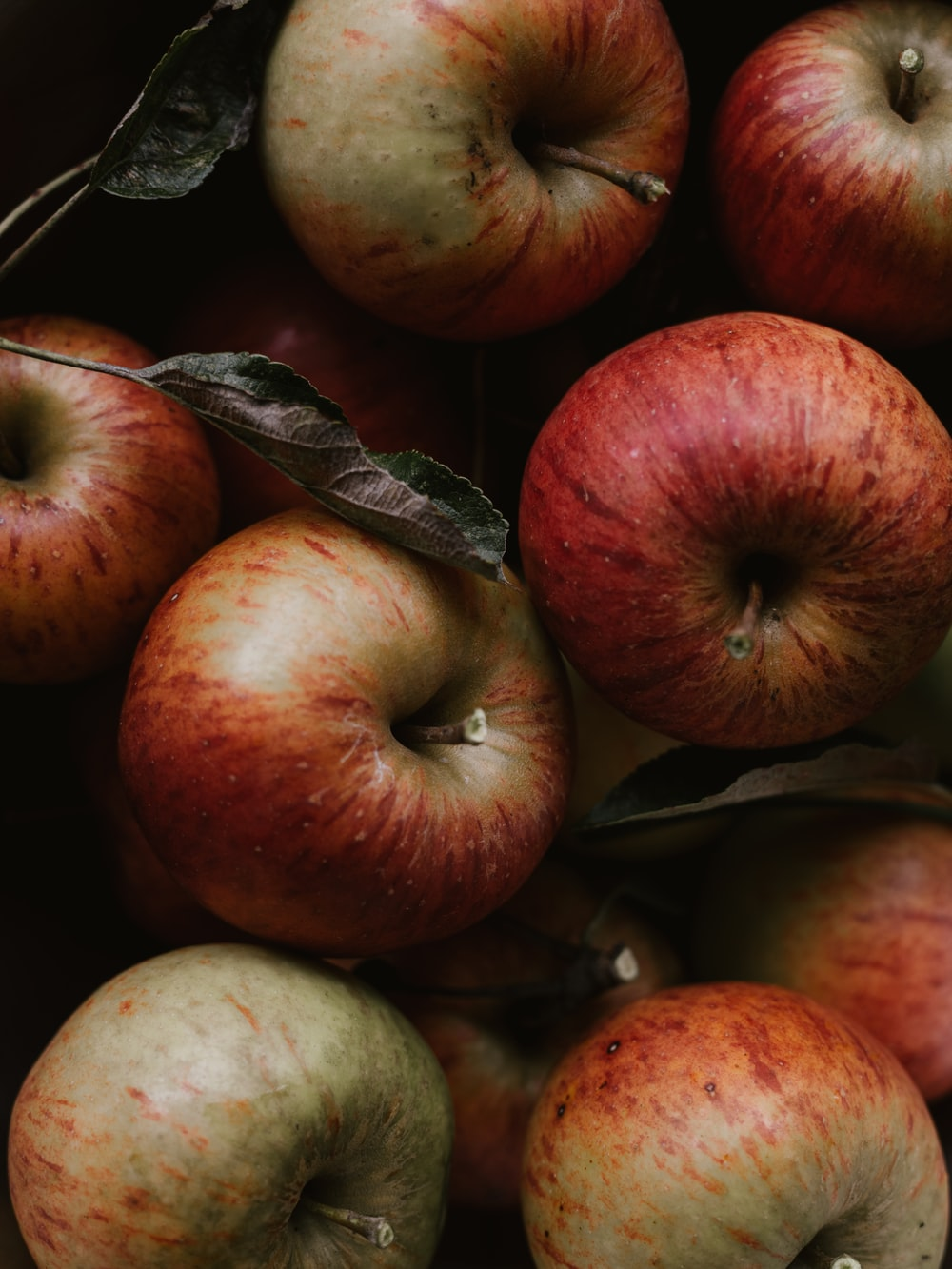 red apples on brown wooden table