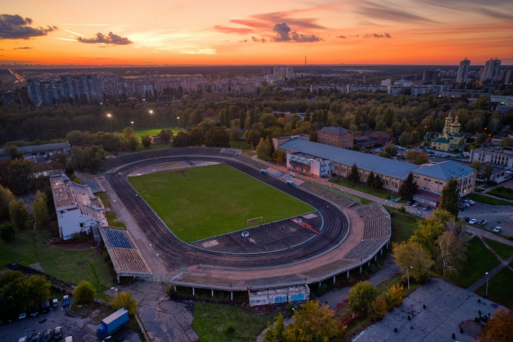 aerial view of football field during sunset