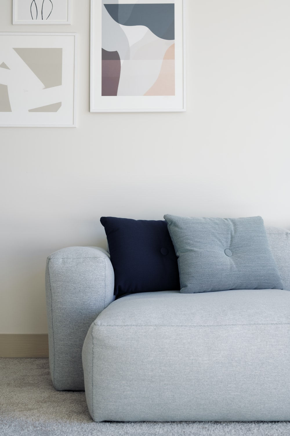 white throw pillow on white couch