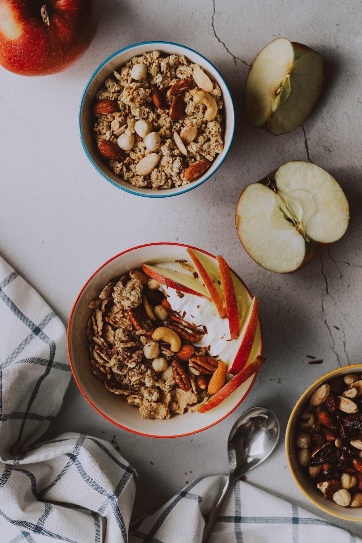sliced apple on white ceramic bowl