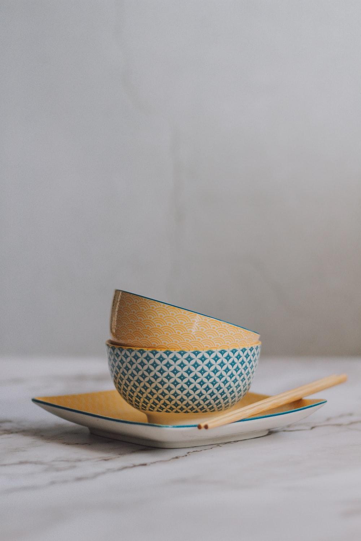 white and blue polka dot ceramic mug on white and blue plate