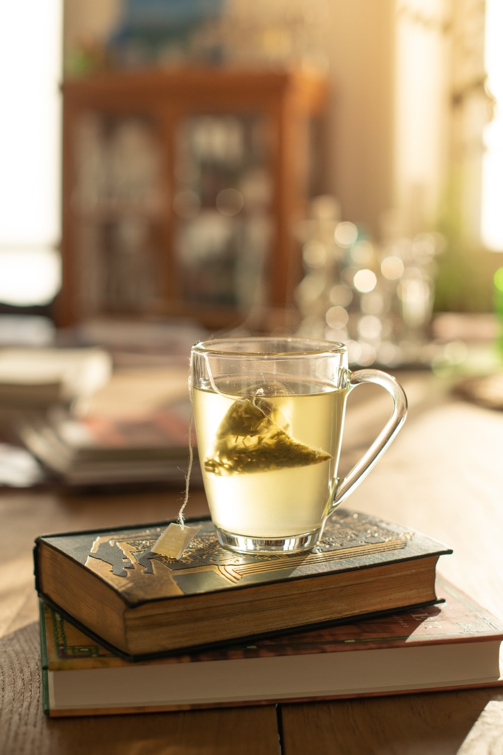 clear glass mug on brown wooden tray