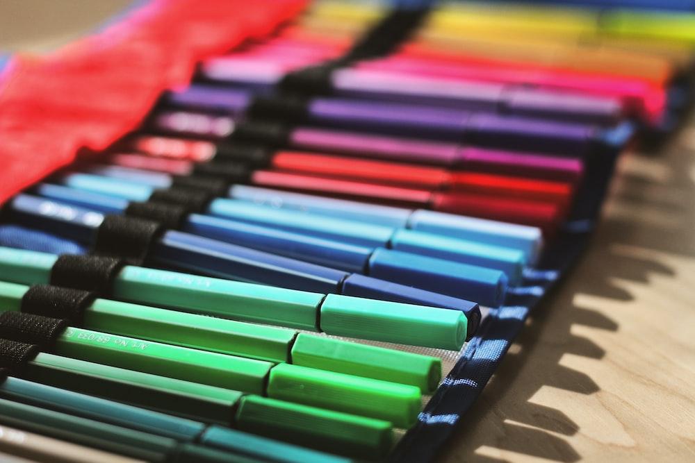 multi colored coloring pencils on brown cardboard box