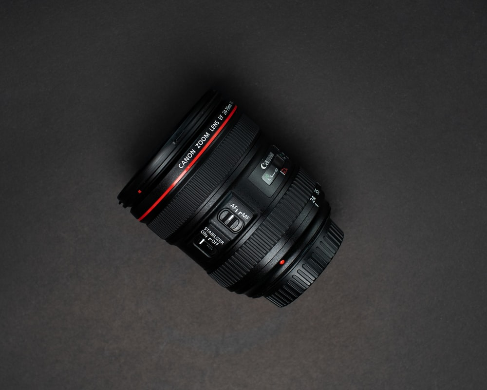 black nikon dslr camera lens
