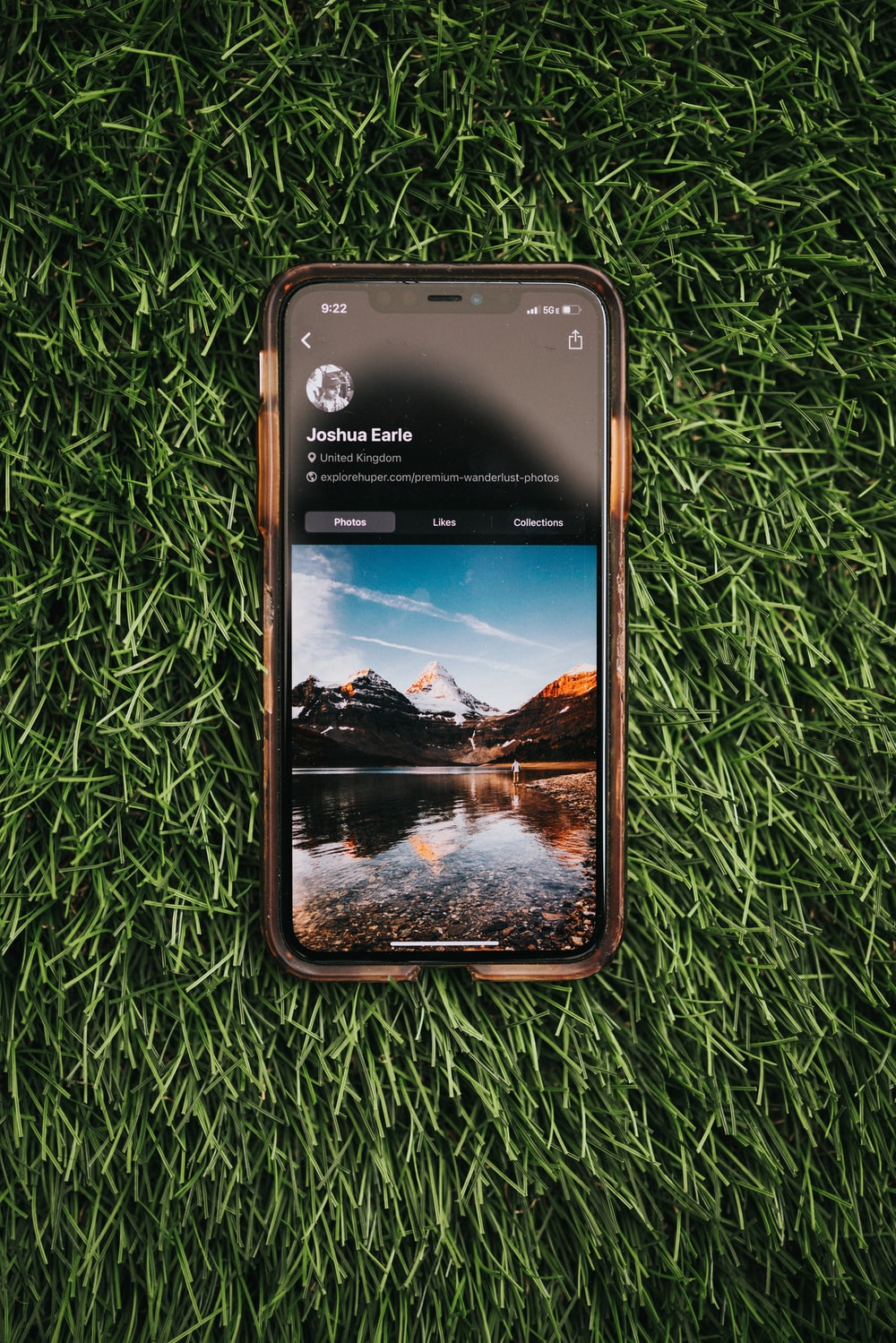 black samsung android smartphone on green grass