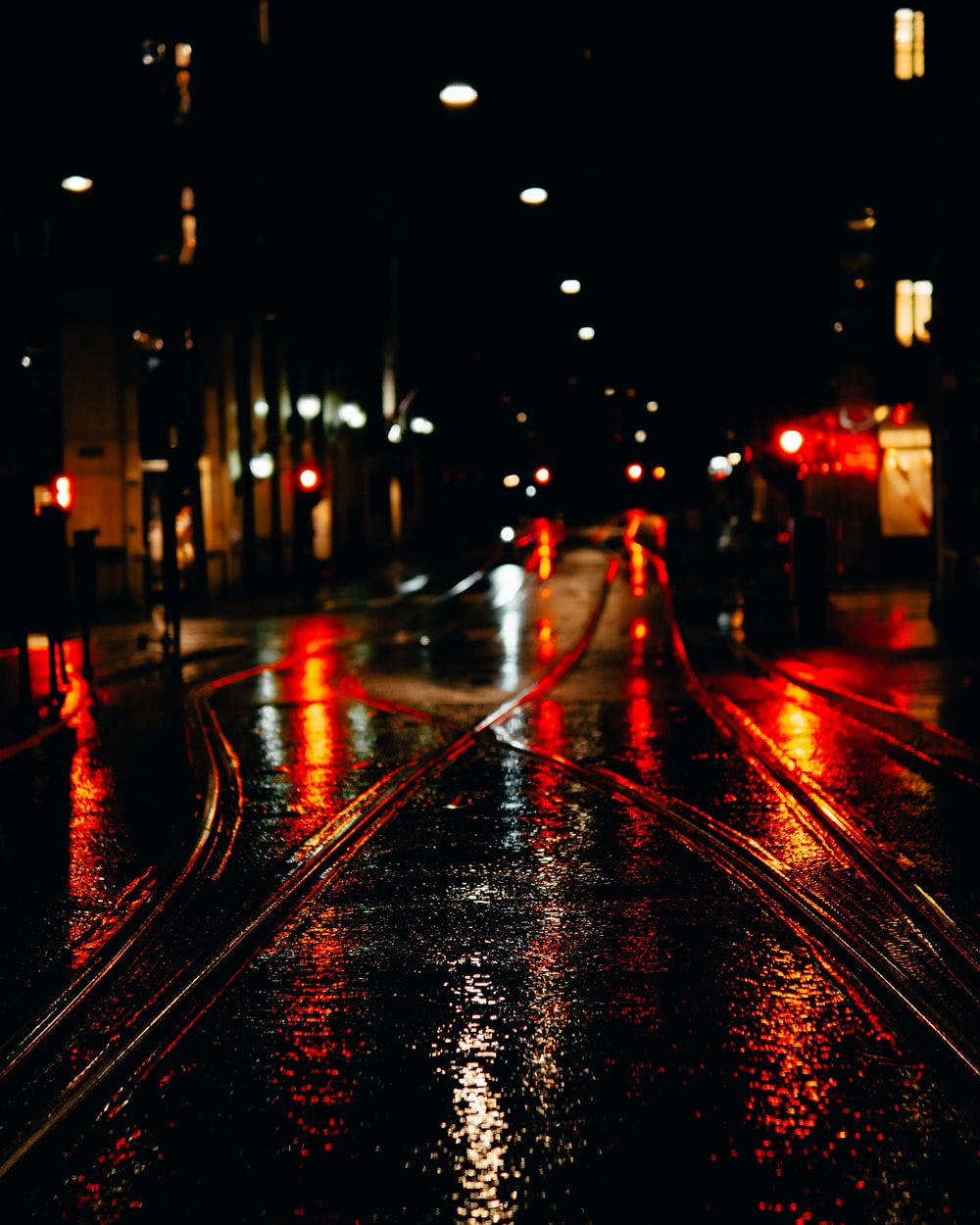 city street with cars during night time