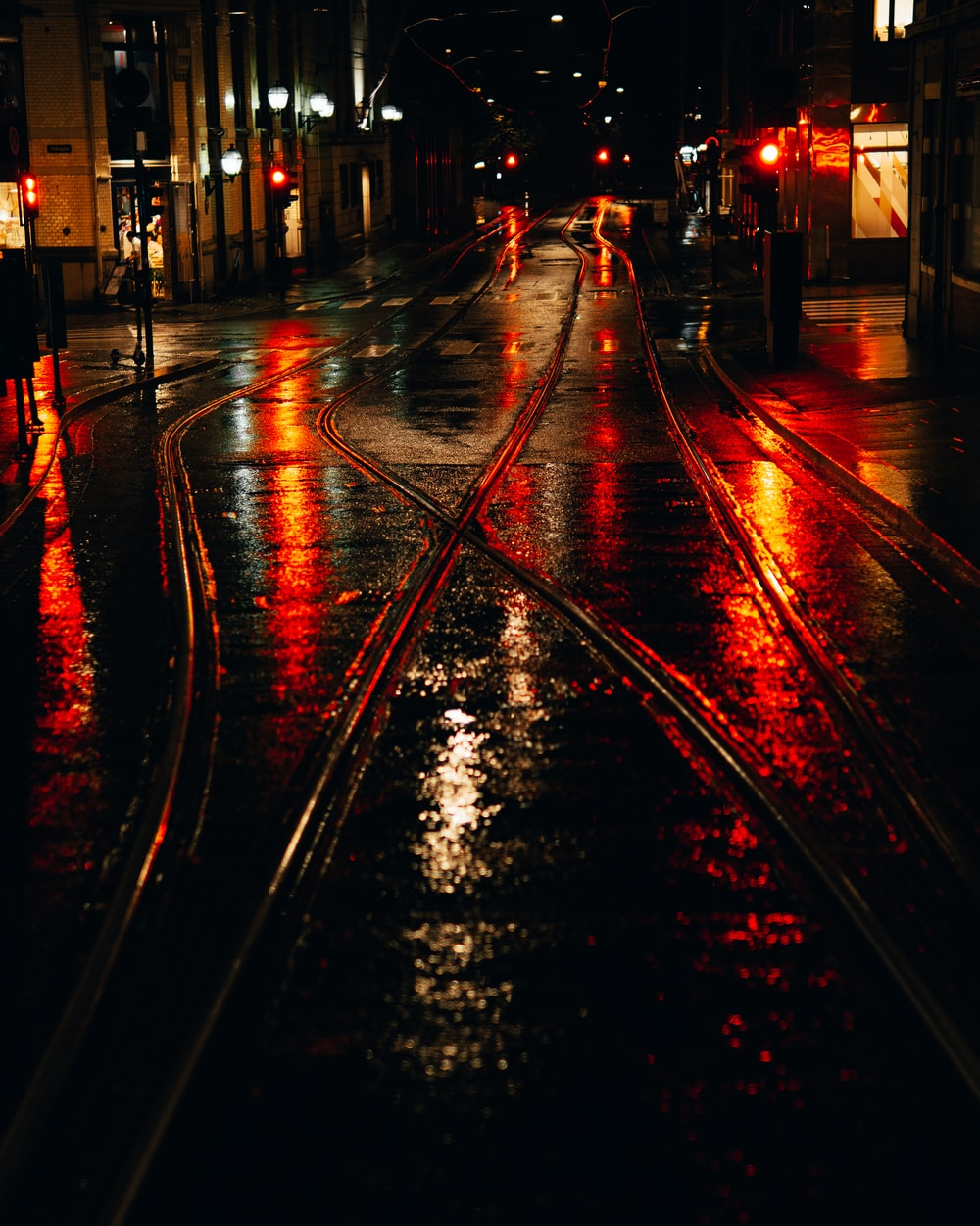 city street with red lights during night time