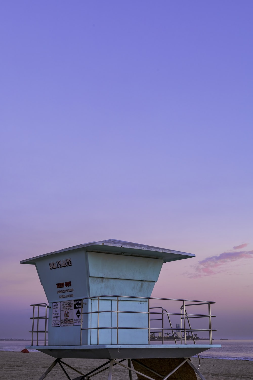 white and red lifeguard house under blue sky during daytime