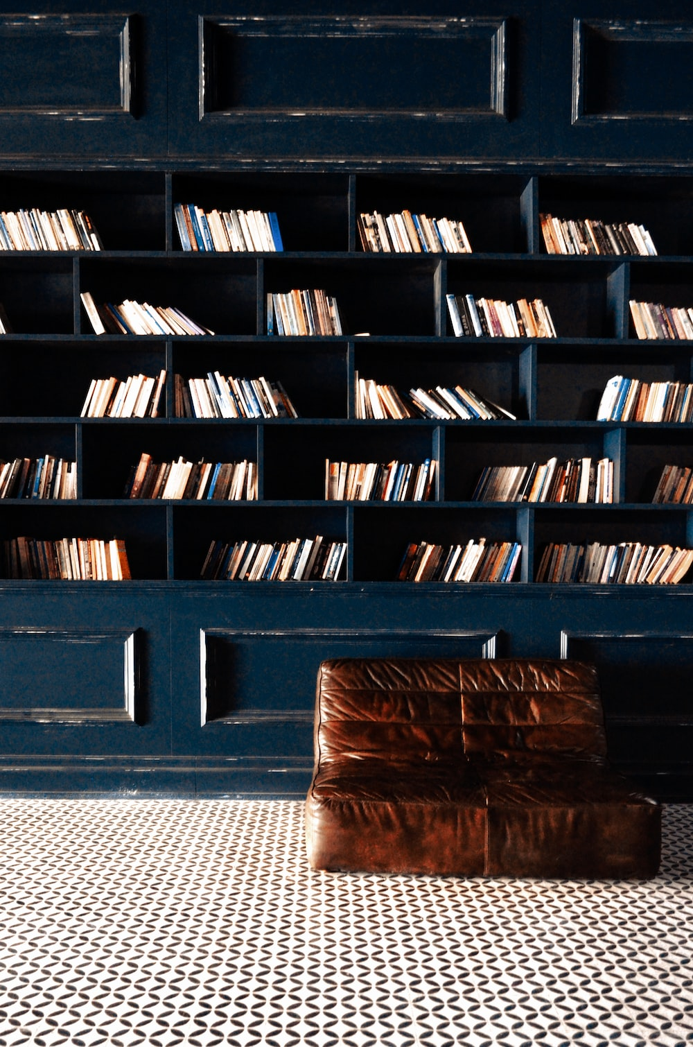 brown wooden book shelf with books