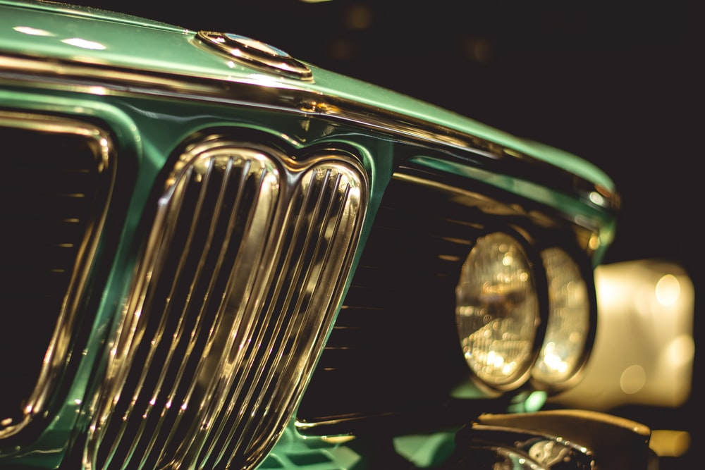 green and silver car with light