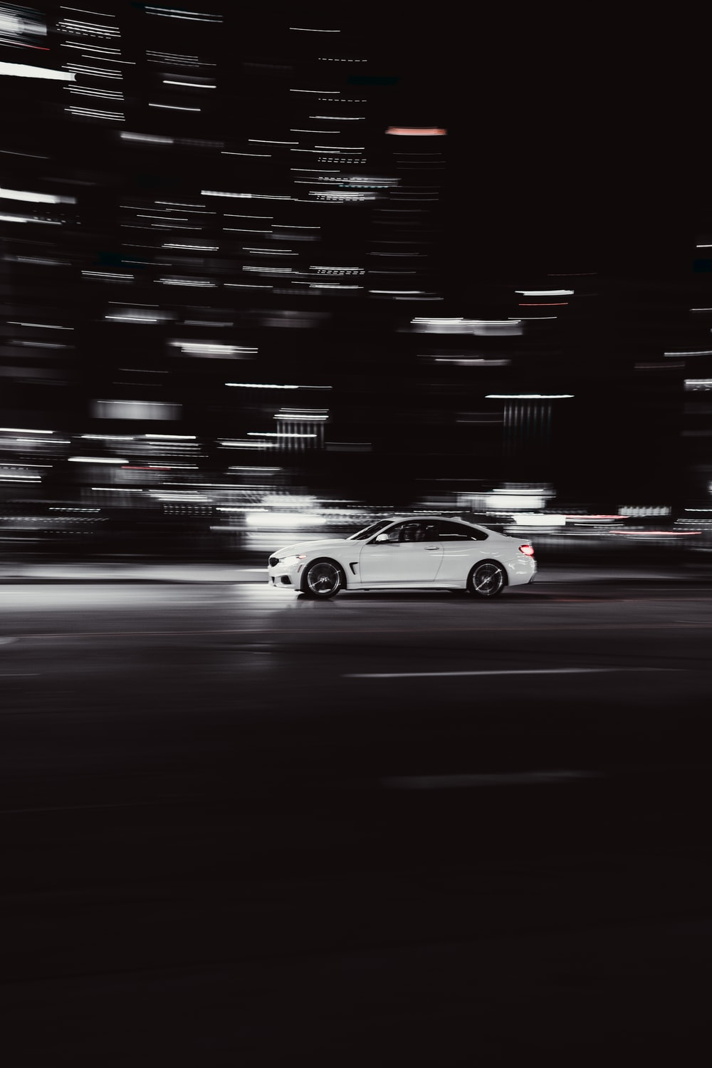 white coupe on road during night time