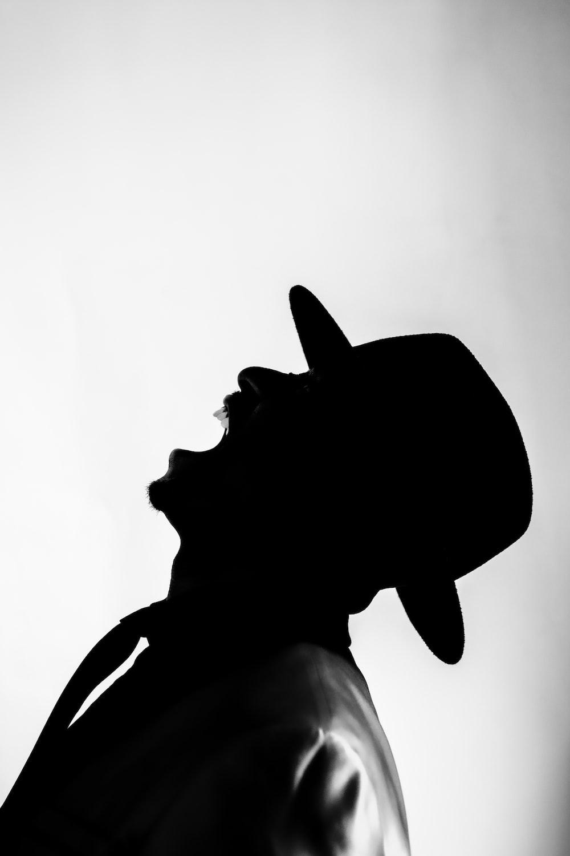 silhouette of woman wearing hat