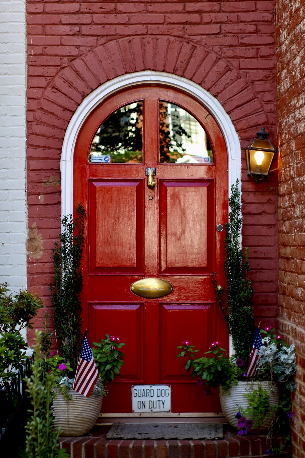 red wooden door with yellow and red flowers