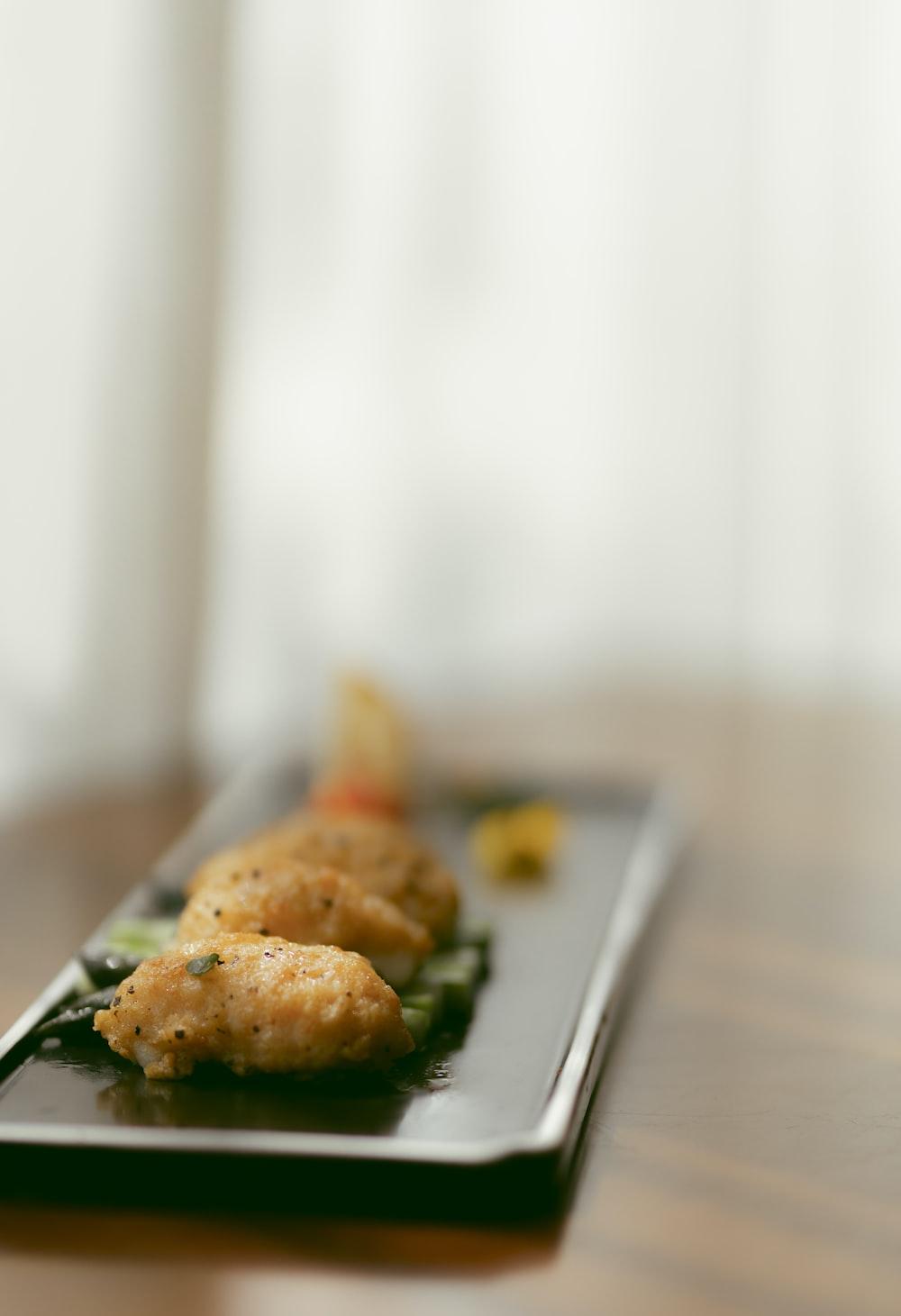 fried food on black plate